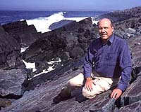 Paeleontologist Guy Narbonne at his Mistaken Point exploration site on the coast of Newfoundland. Photo by Greg Locke